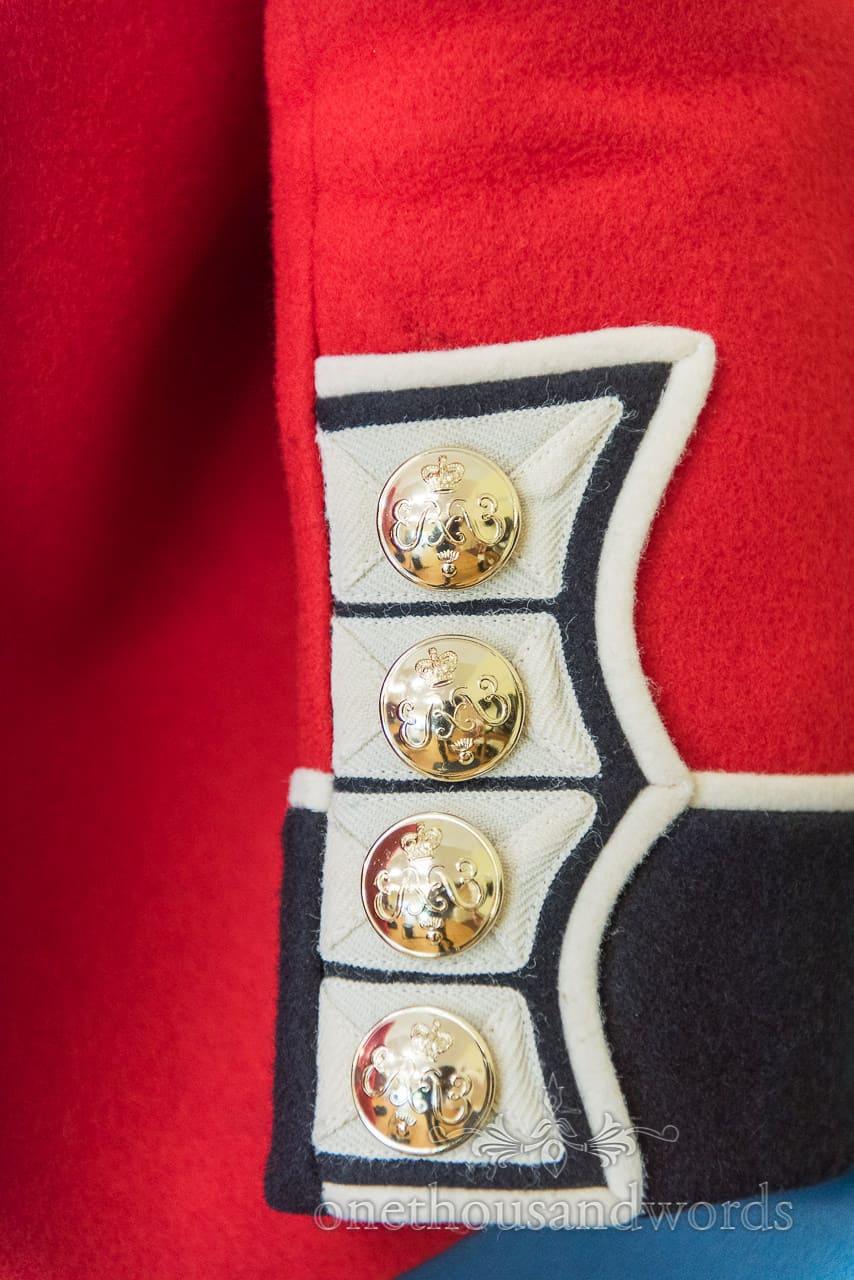 Woollen Military Red Uniform sleeve with Golden Buttons wedding Detail Photograph