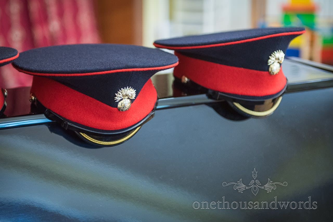 Coldstream guards Military Wedding Groomsmen Hats in Blue and Red wool with golden badges detail wedding photograph