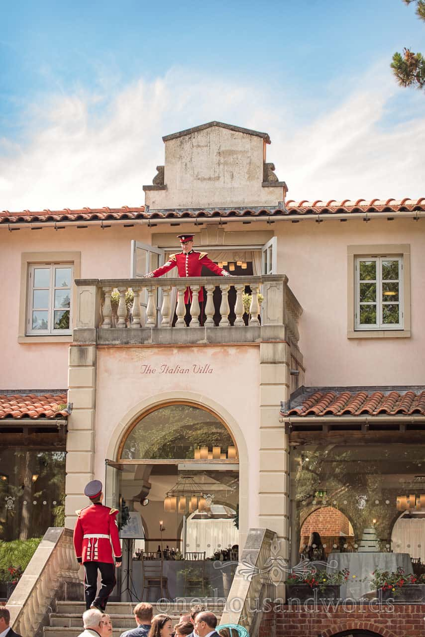 Military Wedding with guests in Red Uniforms at Italian Villa wedding venue on stone Balcony and stone stair case