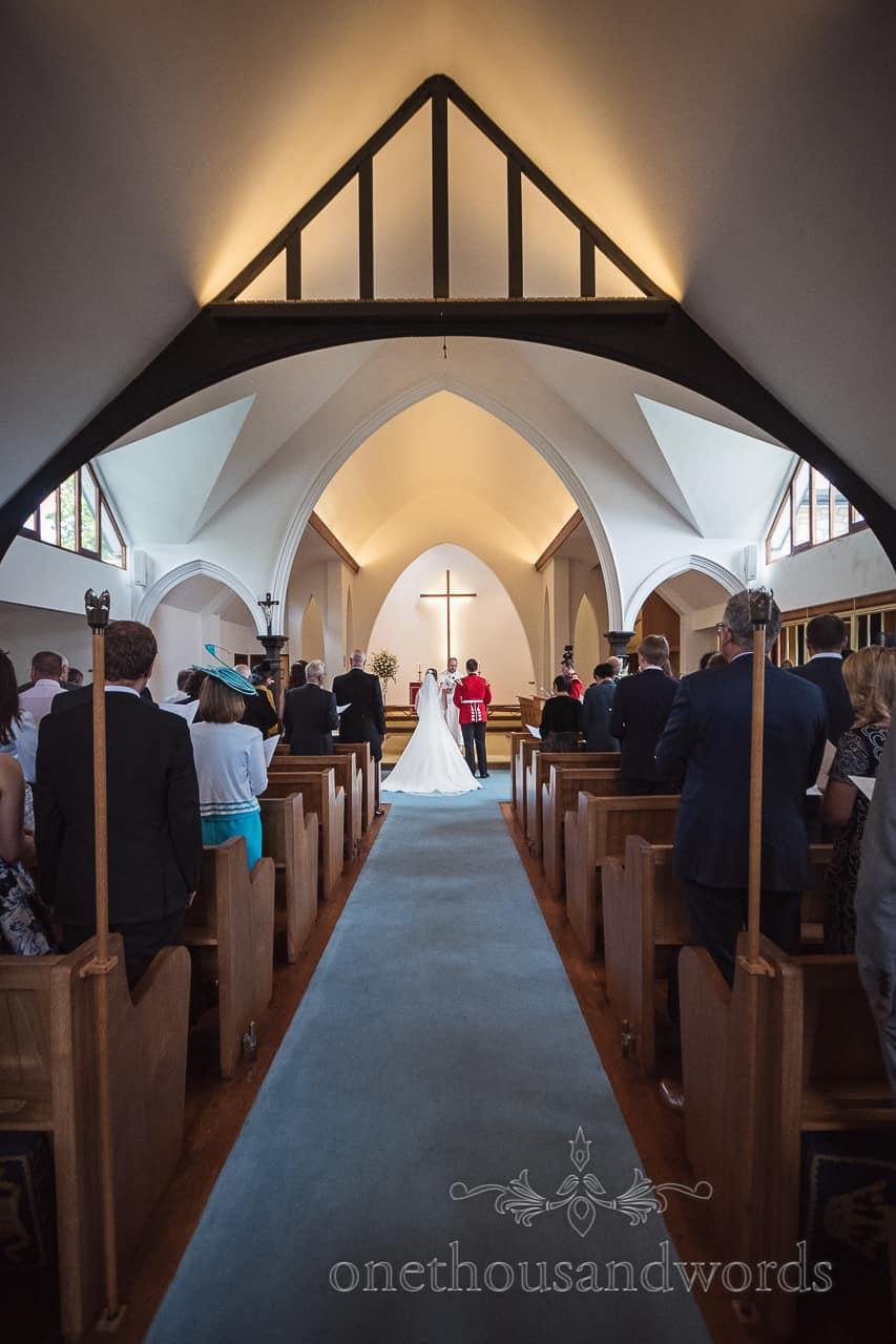 The Church Of The Transfiguration Sandbanks Wedding Ceremony Church Photograph taken down the aisle