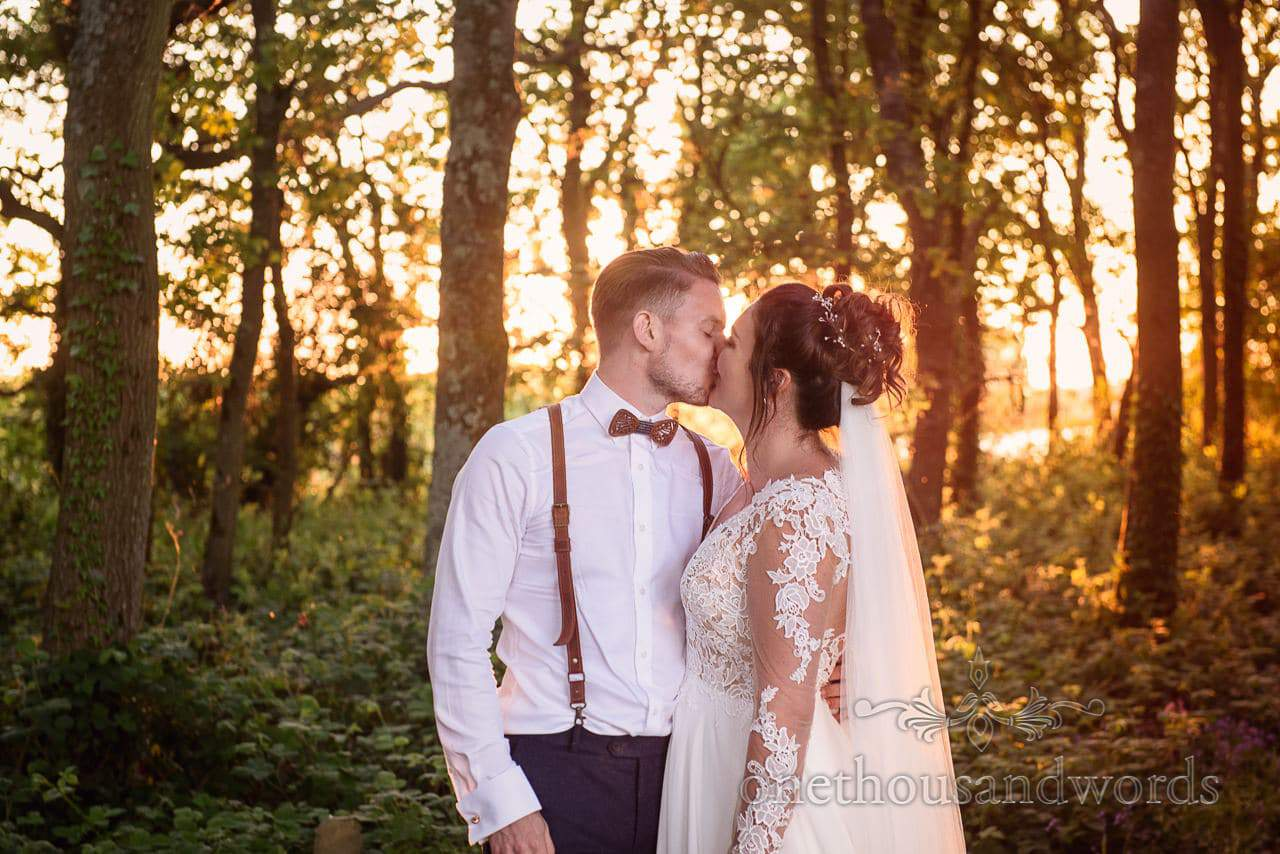 Sopley Lake Sunset Woodland Bride and Groom Kissing Photograph by one thousand words photographers at Sopley Lake wedding