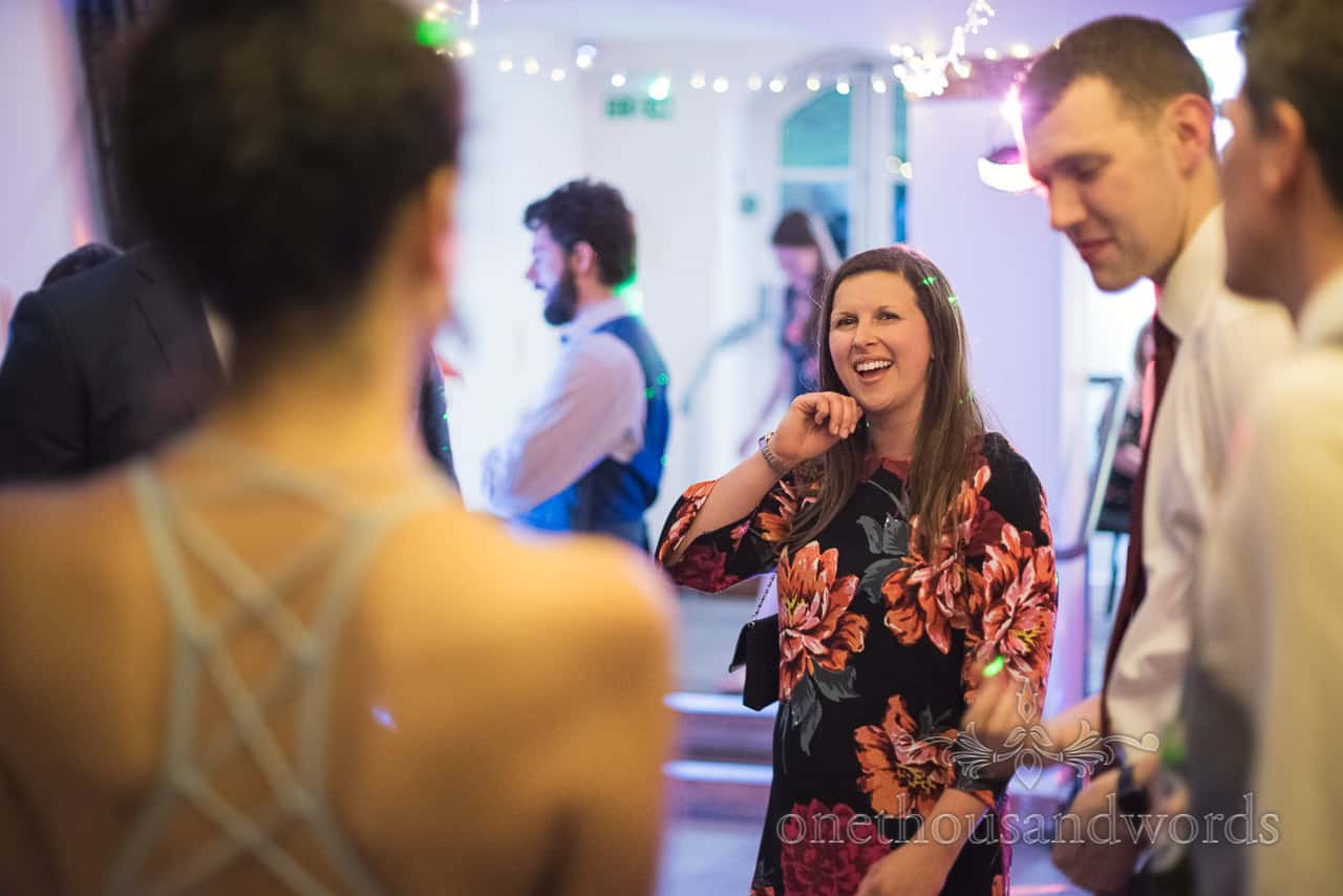 Wedding Evening Disco happy Guest in black and orange Floral Dress Dancing under disco and fairy lights