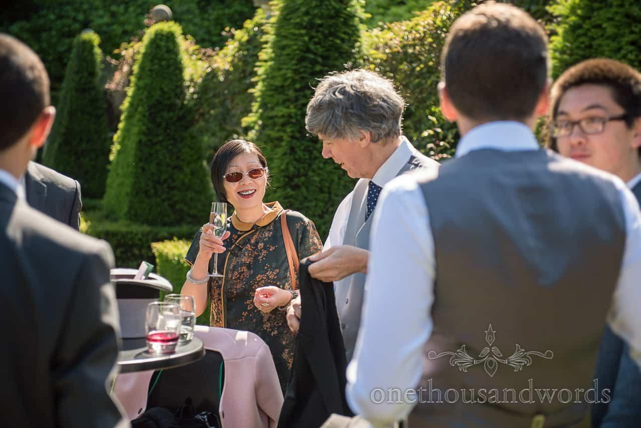 Happy wedding Guest in silk floral dress at Italian Villa Drinks Reception Photograph