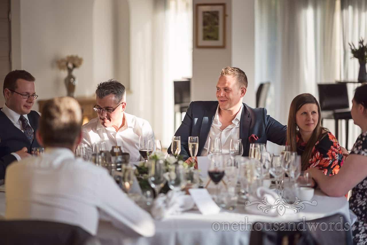 Wedding Guest Smiling in the Sunshine at Wedding Breakfast Table in Italian Villa wedding venue in Dorset