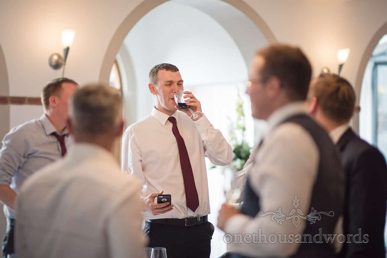 Happy Wedding Guest Times The Wedding Speeches for a sweep stake on phone Whilst Drinking Red Wine