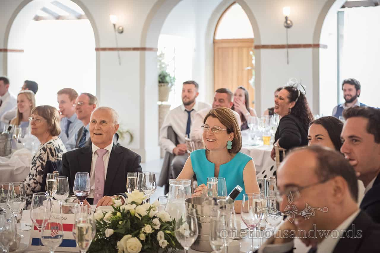 Wedding Guests Laughing as they watch the Wedding Speeches at The Italian Villa Wedding venue Photograph