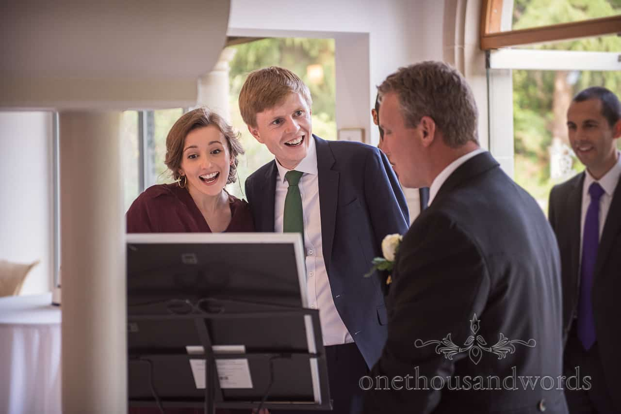 Happy Wedding Guests Read the wedding Table Plan before Wedding Breakfast at the Italian villa wedding venue