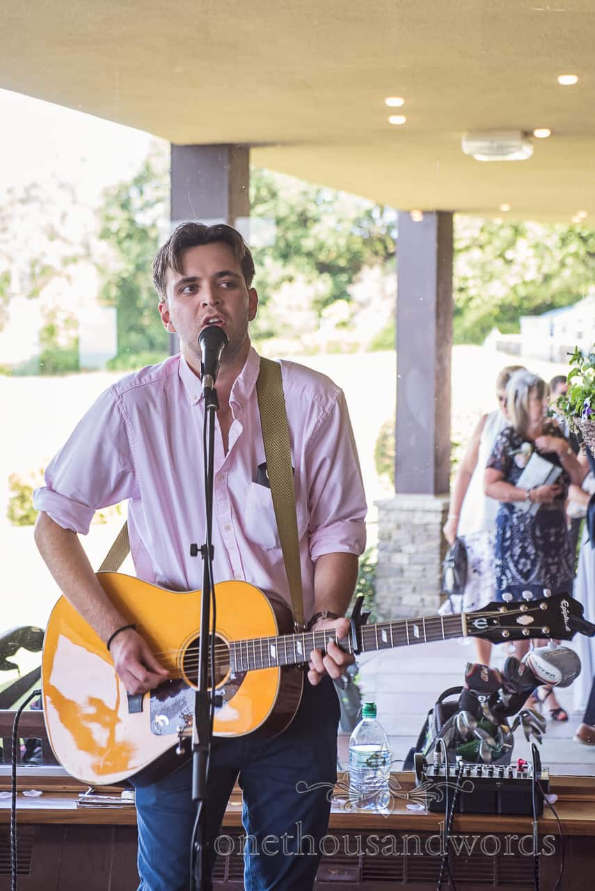Acoustic guitarist at wedding reception for musical entertainment