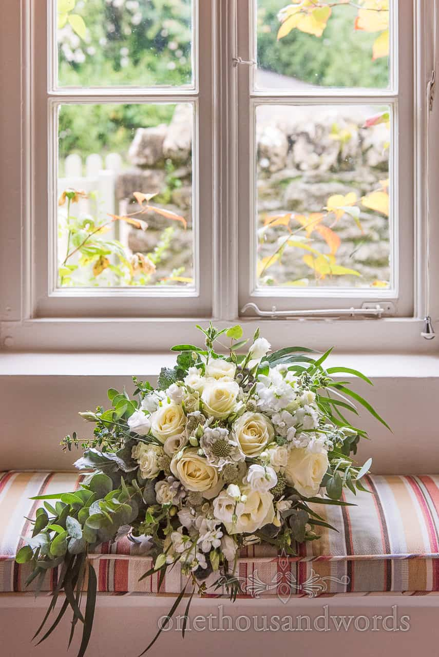 Beautiful white and yellow floral bridal bouquet in Dorset wedding cottage window seat
