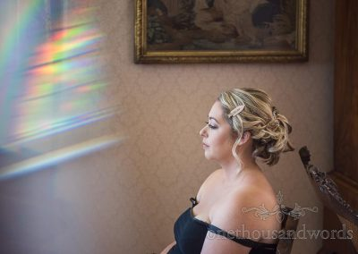 Blonde bride wedding hair styled on wedding morning documentary photograph with prism rainbow