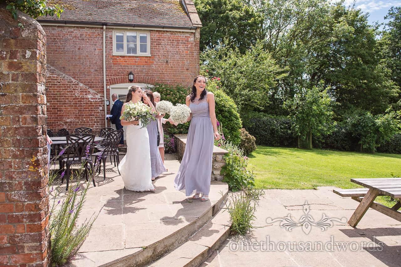 Whole bridal party leave Symondsbury Estate cottage on wedding morning bathed in sunshine