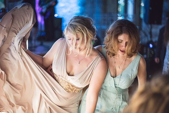 Bride and bridesmaid dancing over twelve hours after wedding photography coverage started
