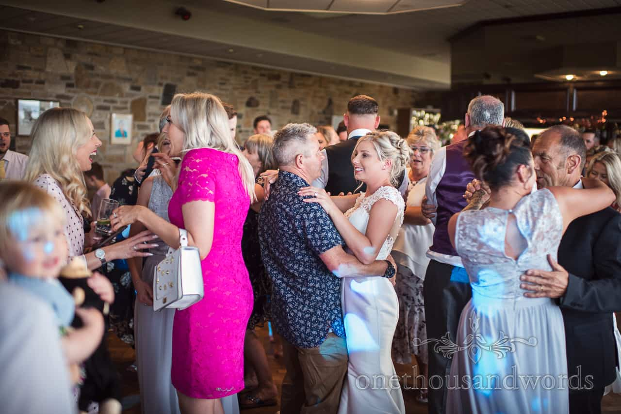 Bride and father dance surrounded by wedding guests on the dance floor at Golf club reception
