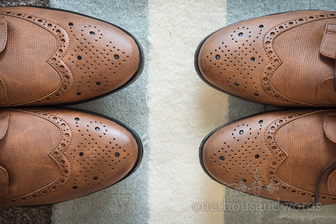 Brown Oxford Brogues wedding shoes detail wedding photograph on blue and white striped carpet