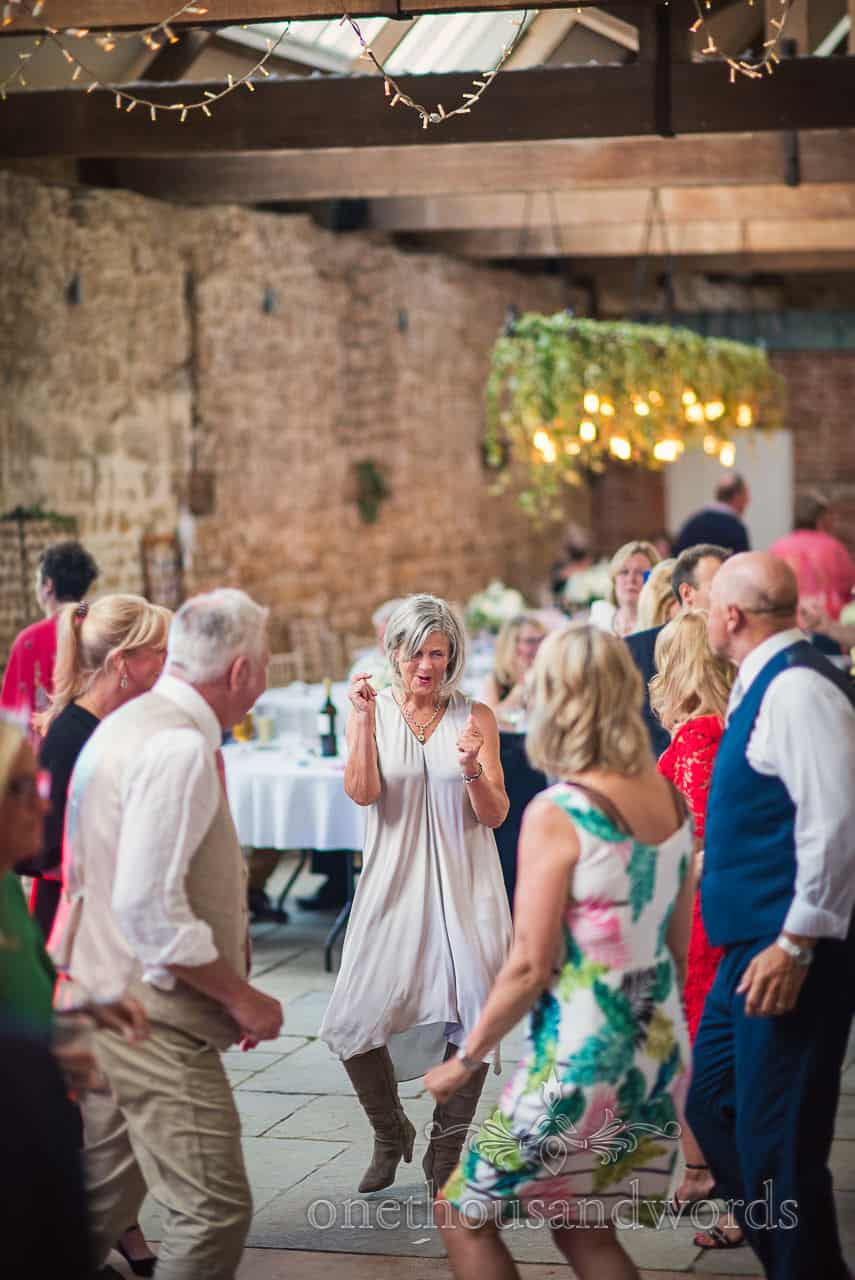 Crazy wedding guest dancing during evening entertainment at the Tithe Barn wedding venue