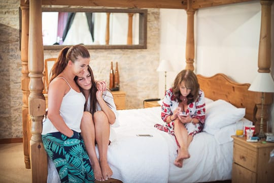 Wedding photographers with no time limits capture bride hugging mother on wedding morning in Dorset venue