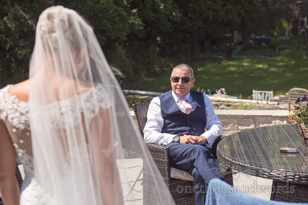 Fathers first look at bride in wedding dress on wedding morning