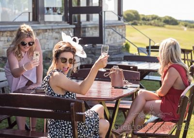 Female wedding guests enjoying drinks during reception at Purbeck Golf Club