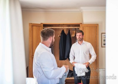Groom and best man wear white shirts on Dorset wedding morning preparation photograph
