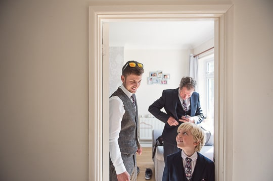 Groom and son photographed on wedding morning