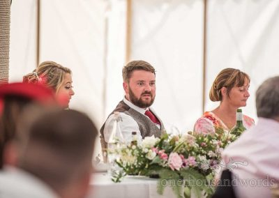 Grooms horrified face reaction to best man's story during speech at Dorset wedding
