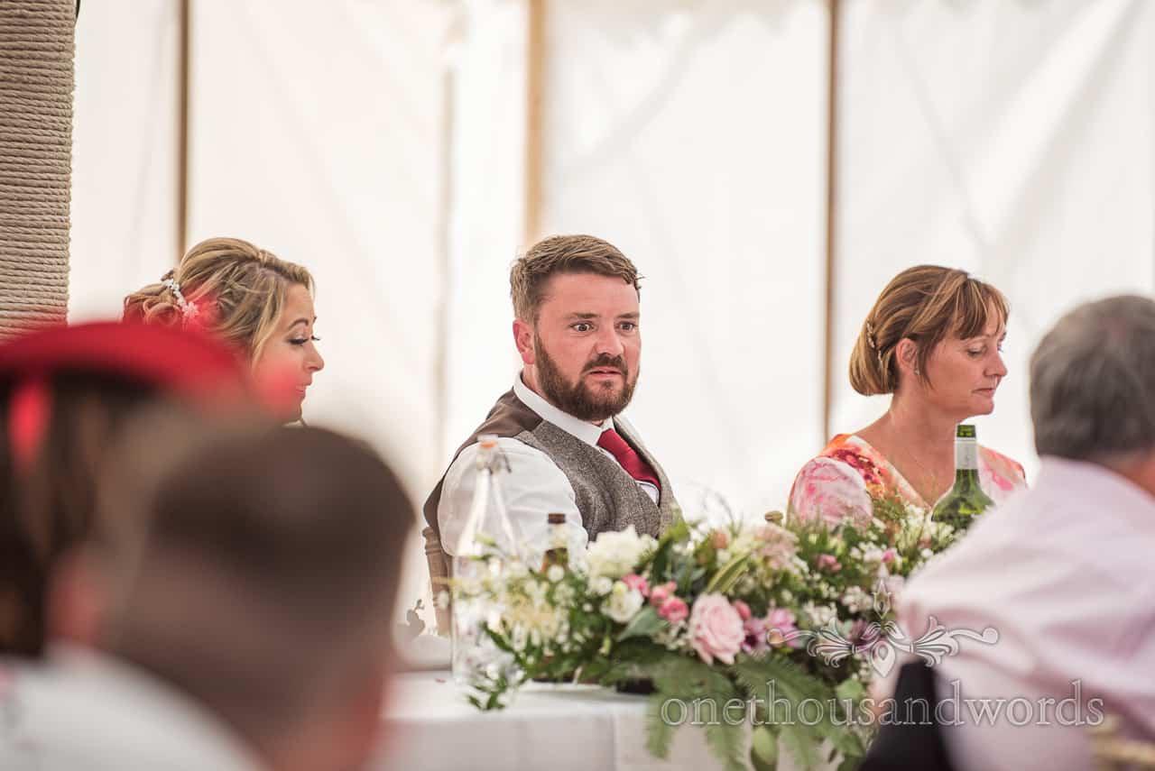 Grooms horrified face reaction to best man's story during speech at Dorset wedding