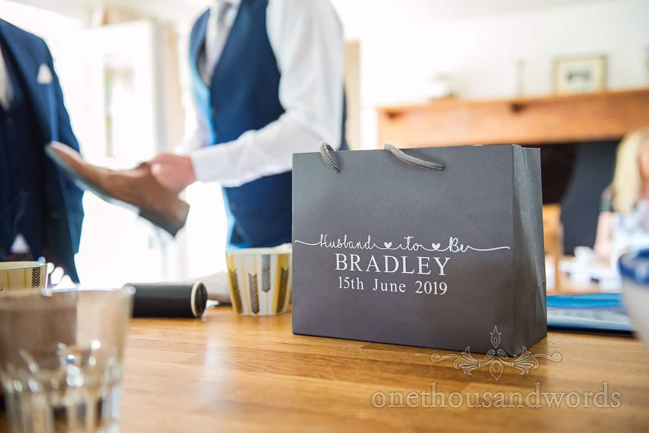 Groom's personalised printed paper gift bag on wedding morning