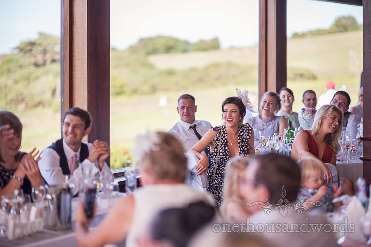 Guests natural laughing reactions to wedding speeches at Purbeck Golf Club wedding venue