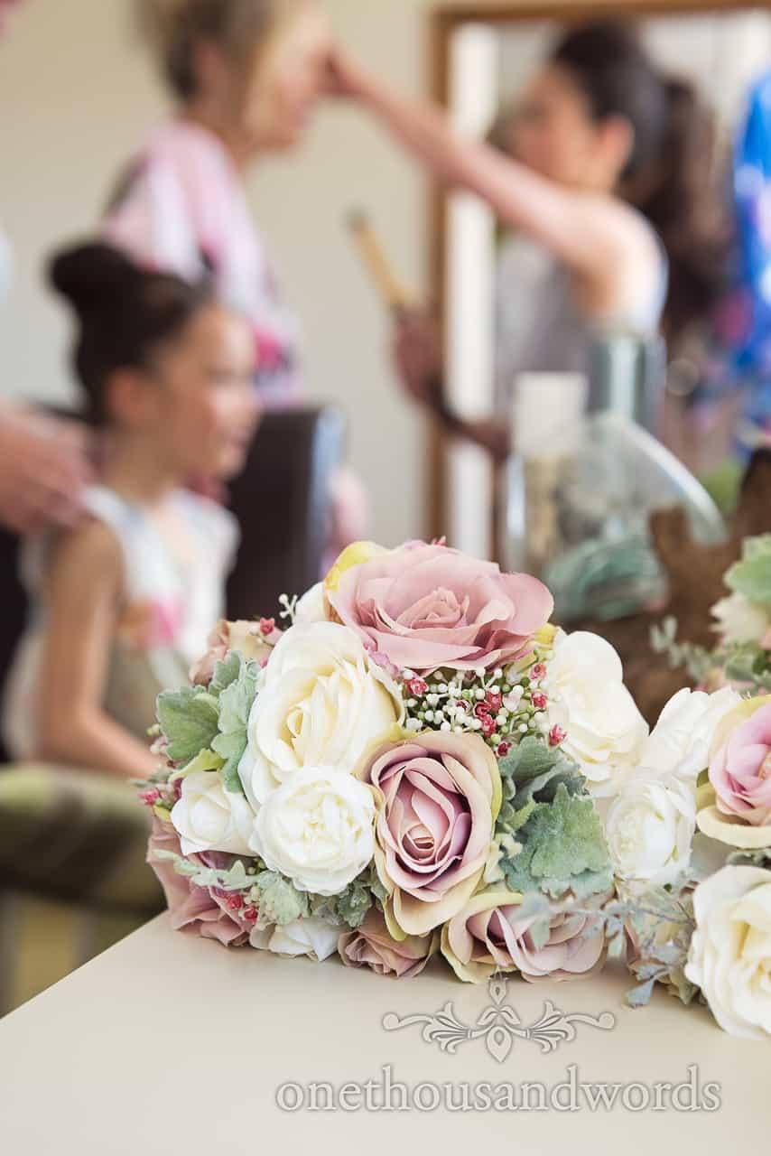 Multicolour pastel wedding flower bouquet close up wedding photograph taken during bridal wedding morning preparation