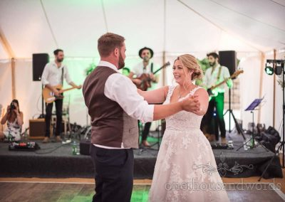 Bride and groom's first dance to wedding band at Studland Bay House marquee wedding venue in Dorset