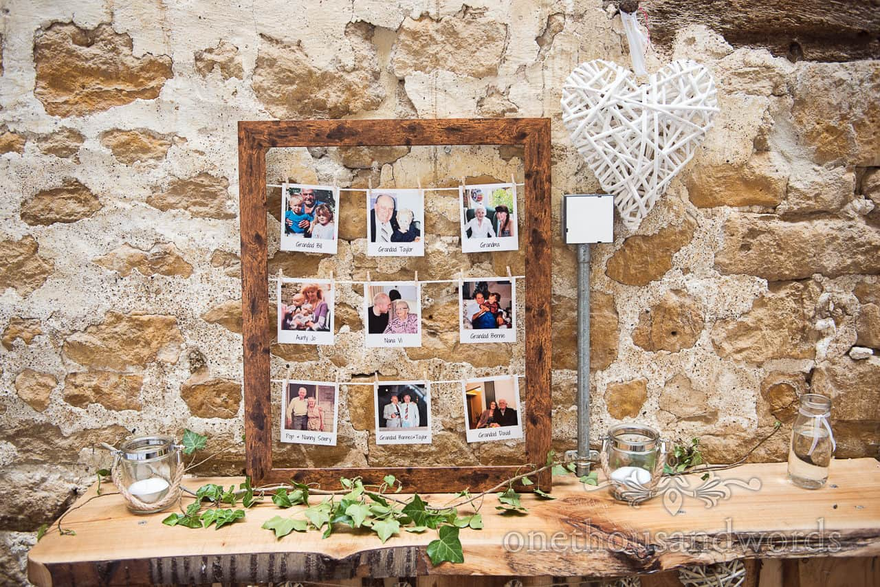 Wedding detail photograph of Polaroid framed pictures of absent Friends and family at stone Barn Dorset wedding