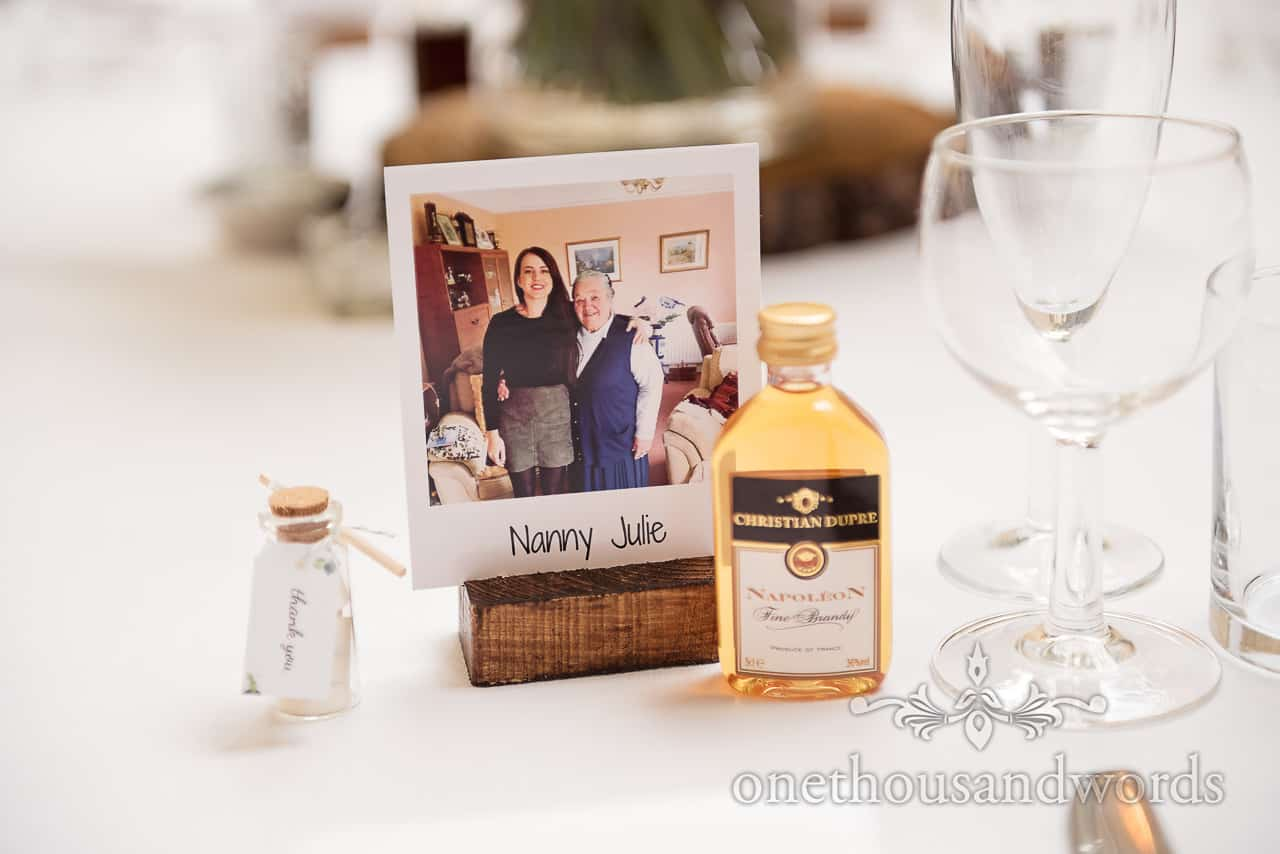 Polaroid photo style place setting sign with message in a bottle bottle wedding favour and miniature alcohol bottle