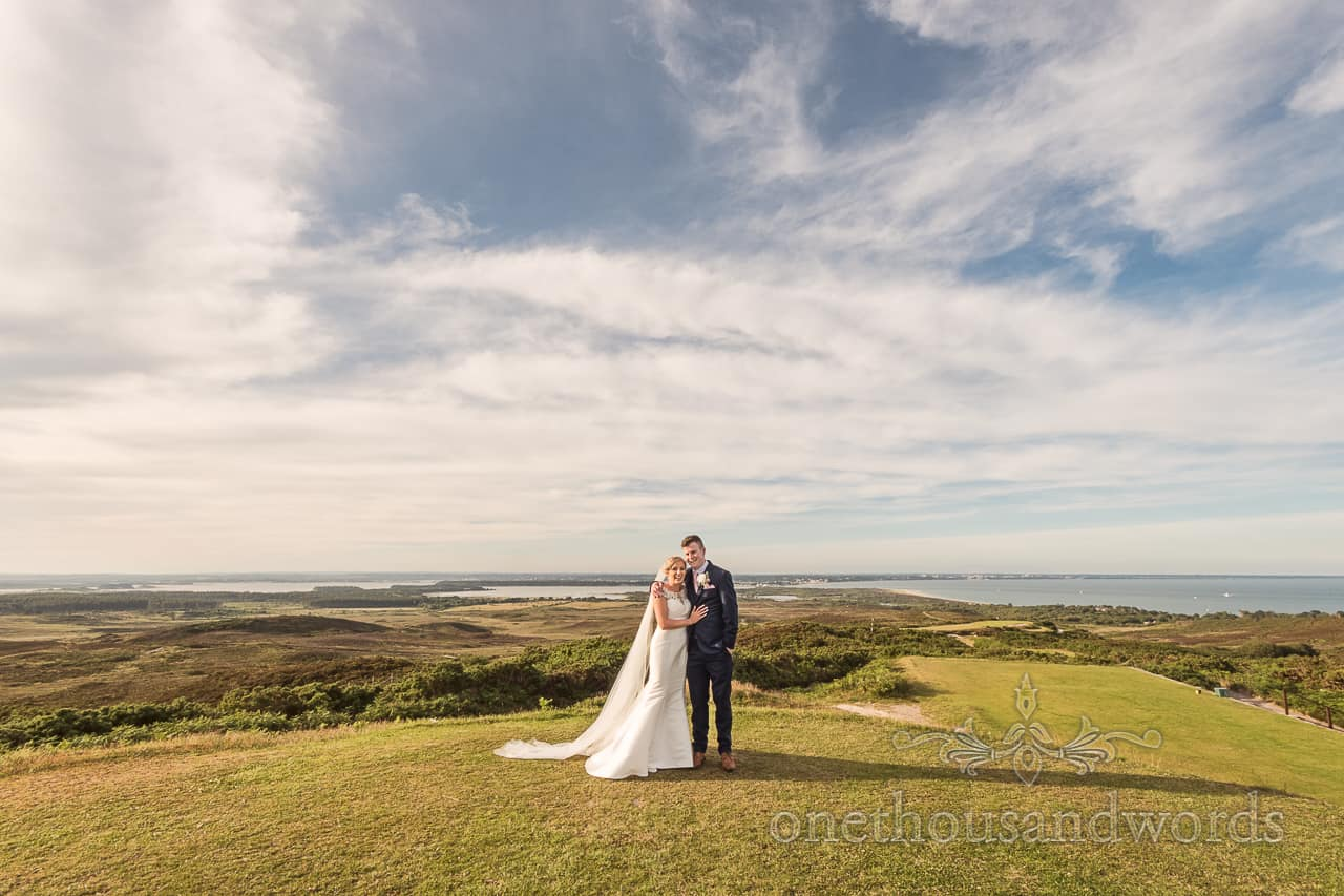 Purbeck Golf Club wedding photographs of bride and groom on greens with view across countryside and Poole Harbour