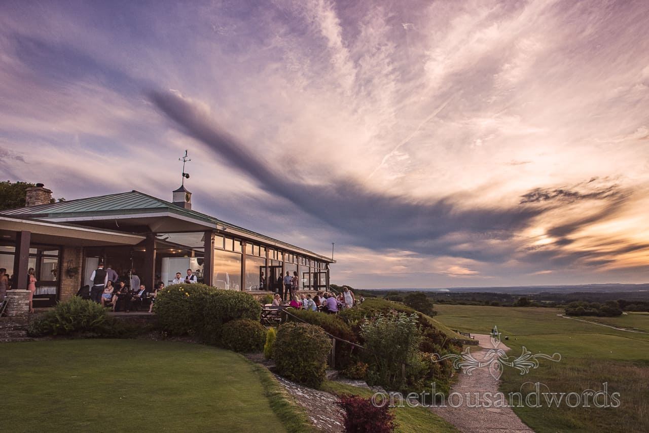 Purbeck Golf Club wedding venue in the Dorset countryside epic sunset and clouds photograph taken on wedding evening