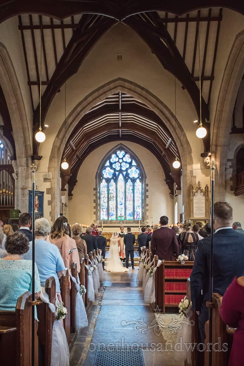 St Marys Church Swanage wedding venue with stained glass window and interesting wooden beamed roof architecture photograph