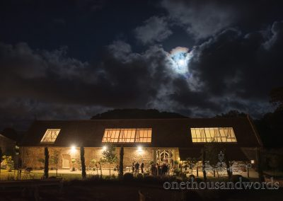 Tithe Barn Dorset wedding venue on Symondsbury Estate photographed at night with moon and clouds