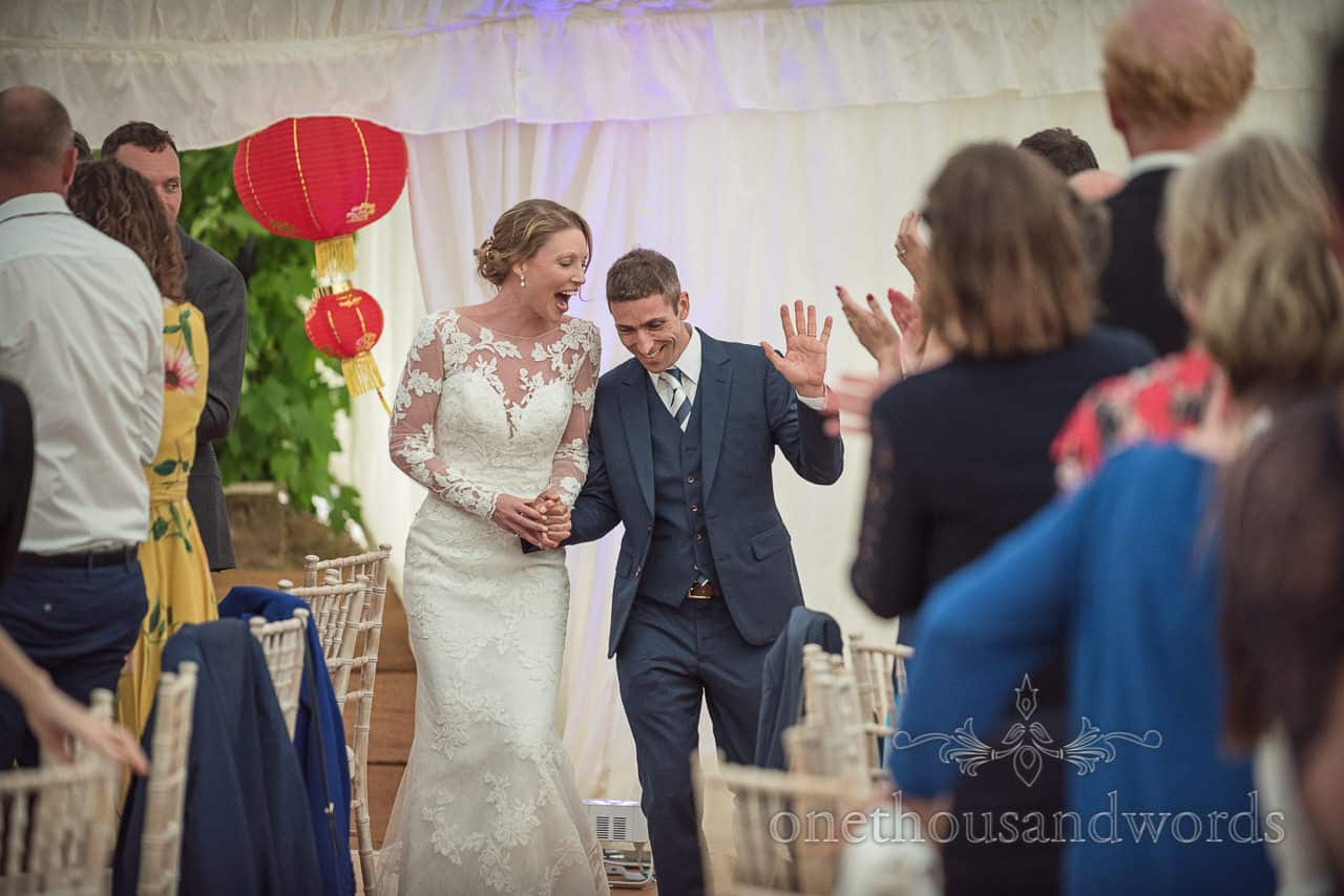 Bride and groom enter Sherborne Castle marquee for wedding breakfast