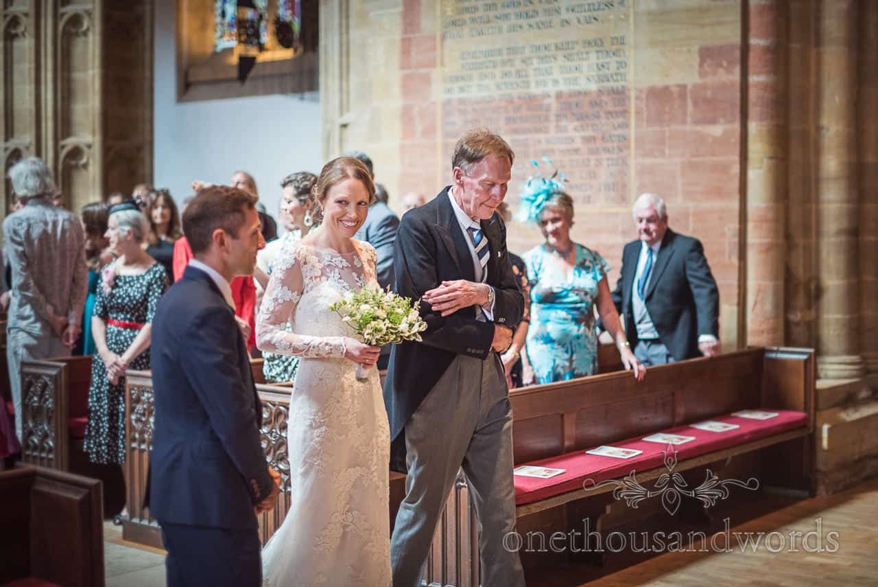 Bride and groom first look photograph at Sherborne Abbey wedding venue