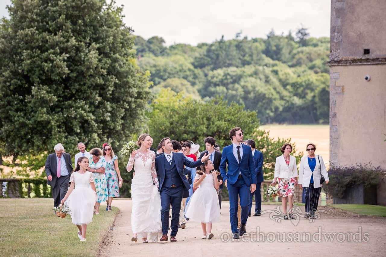 Bride, groom and guests arrive at sherborne castle wedding venue for reception