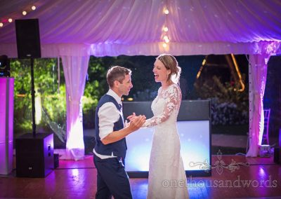 First dance wedding photograph from Sherborne Castle wedding photographs during wedding marquee with disco lighting