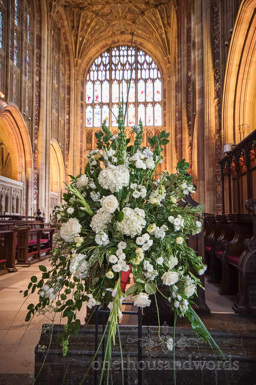 Sherborne Abbey large white and green wedding flower spray in large wedding venue photograph