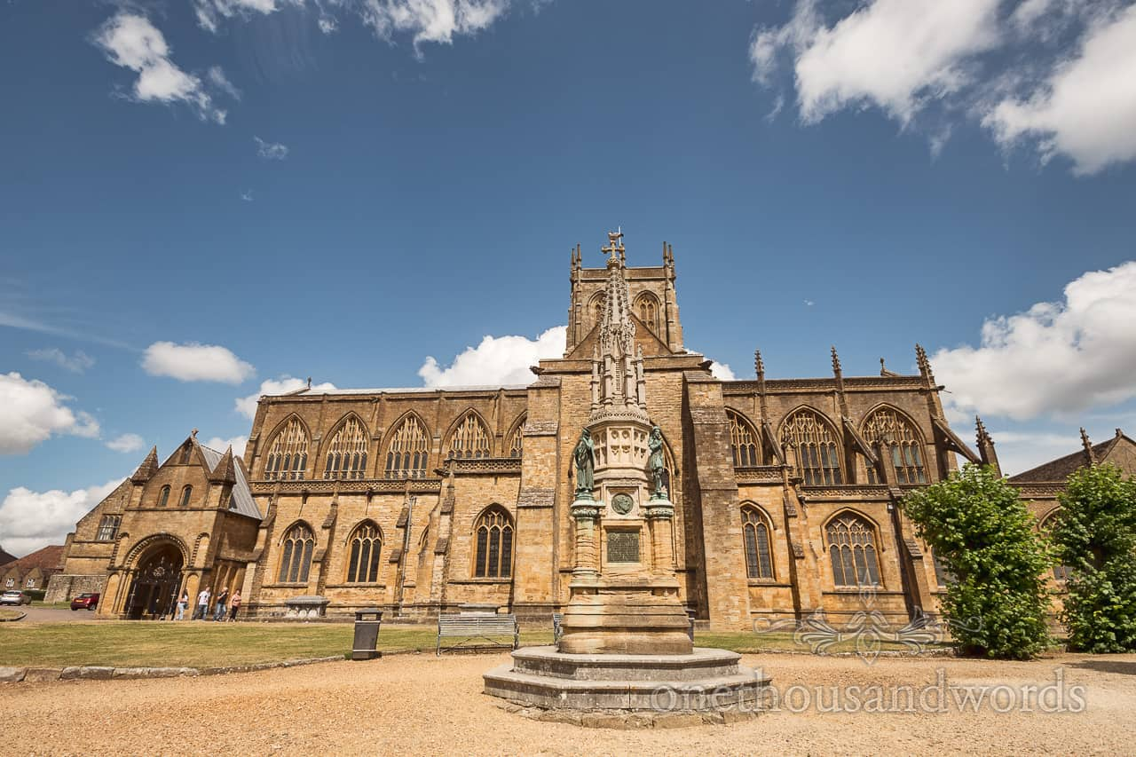 Sherborne Abbey wedding venue in Dorset photograph on summers day with blue skies by one thousand words wedding photography