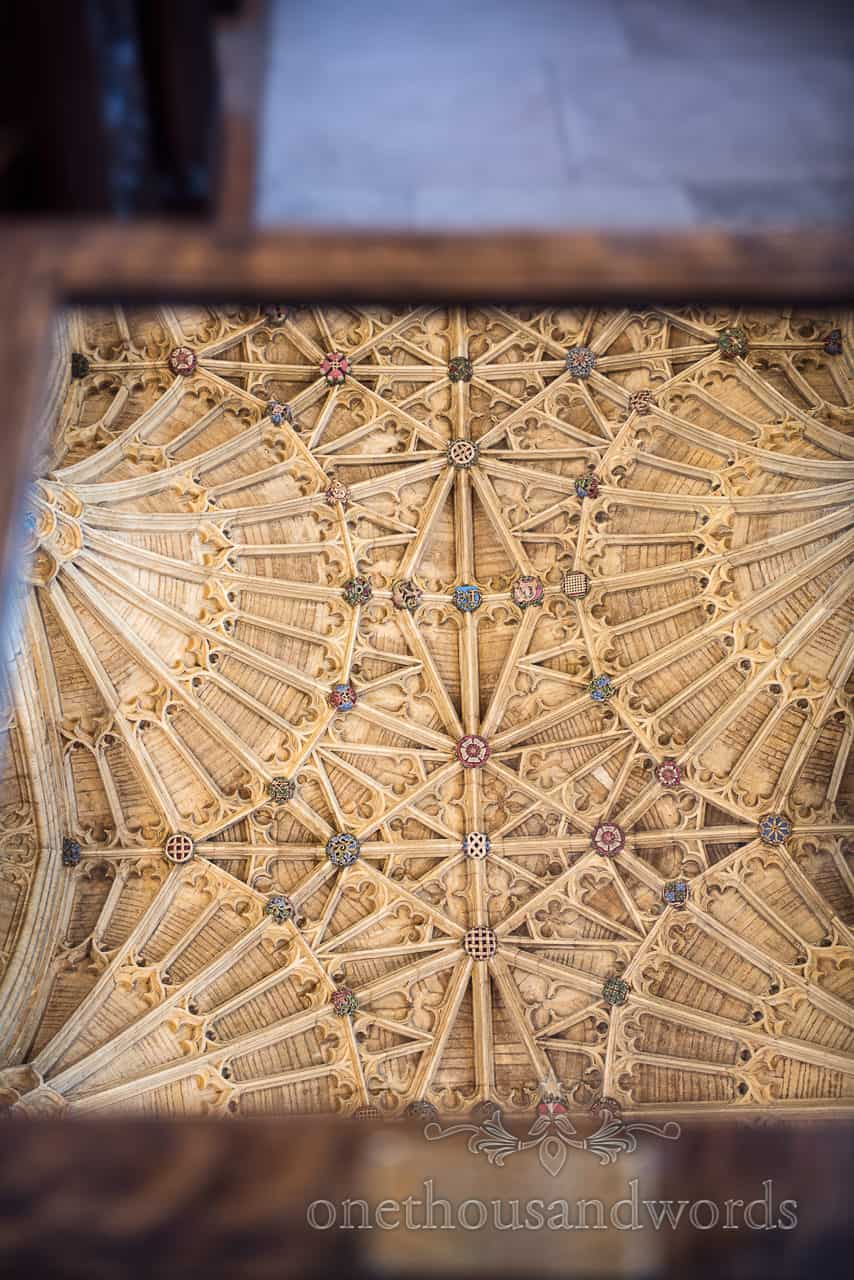 Sherborne Abbey wedding venue in Dorset detailed stone carved roof reflected in a mirror
