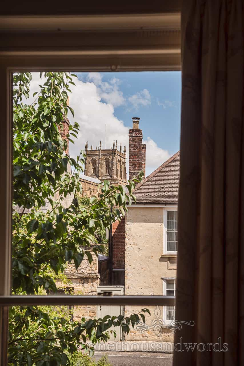 View of Sherborne Abbey wedding venue across houses from bridal preparation window