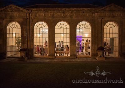 Sherborne Castle Orangery glowing windows at night wedding venue photograph by one thousand words wedding photography