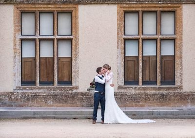 Sherborne Castle wedding photograph of bride and groom outside castle walls by one thousand words wedding photography