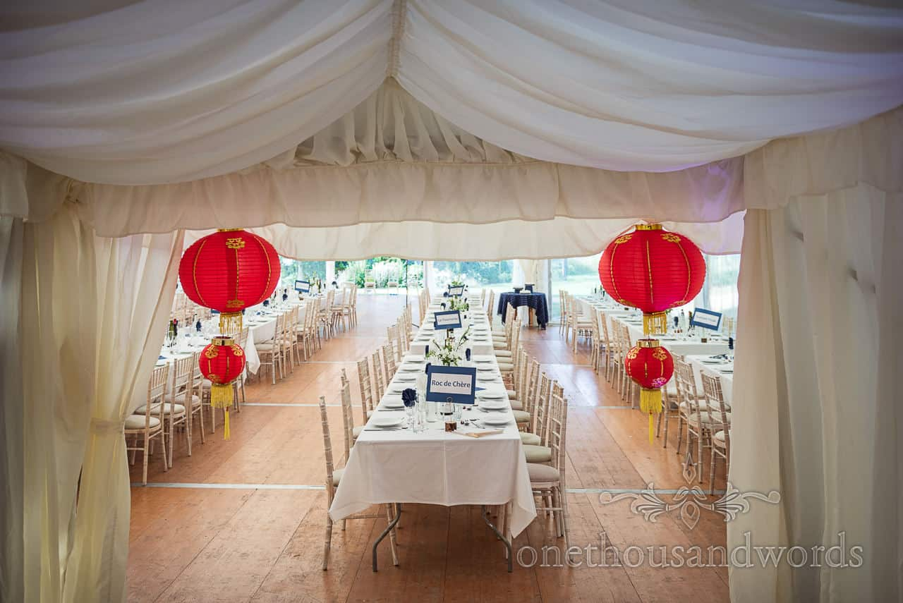 Sherborne Castle wedding photographs of Chinese decorations in wedding breakfast marquee with wooden floor
