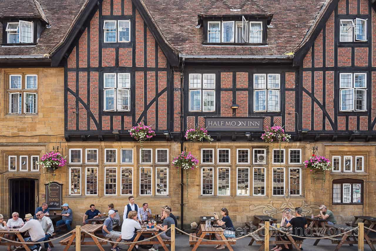 Half Moon Inn Sherborne Pub with groom and wedding guests on wedding morning photographs by one thousand words