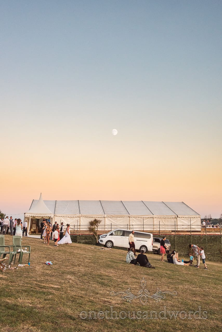 Sunset evening with moon over Purbeck marquee wedding photographs on Swanage hillside