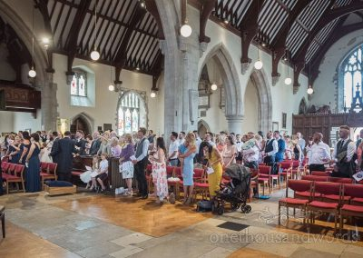 Swanage church wedding ceremony space full of wedding guests watching the bride and groom